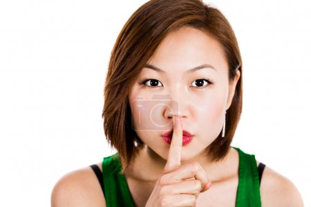 Secret woman with finger on lips