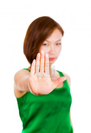 Young woman is showing the stop gesture on white b...