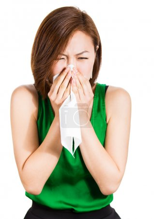 Teenager blowing her runny nose, sneezing