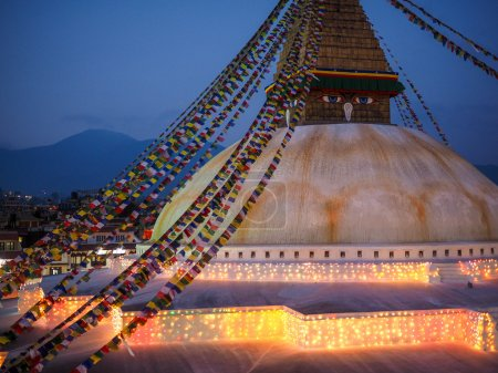 Buddhist shrine Boudhanath Stupa with pray flags