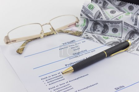 Glasses and pen lie on a resume