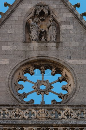 Carved religious scene and stoned empty rose window in Leon cath