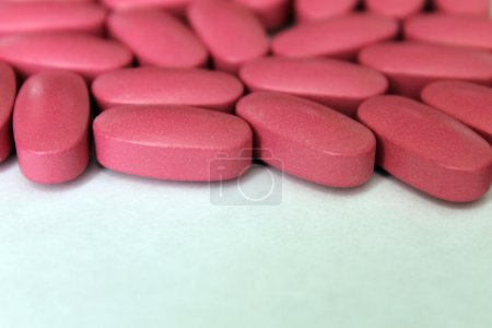Photo for Pink tablets, vitamins, dietary supplement - Royalty Free Image