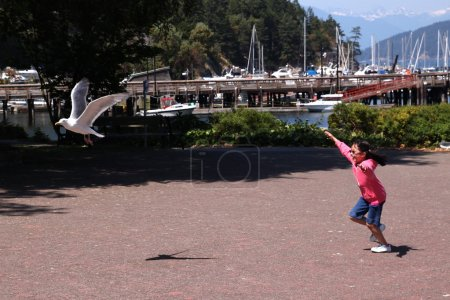 Little Girl Chasing Seagull