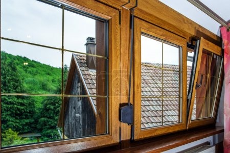 Laminated PVC windows in villagr house