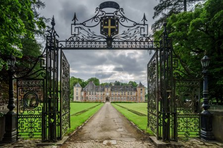 Photo for Old medieval castle view  through metal gates - Royalty Free Image