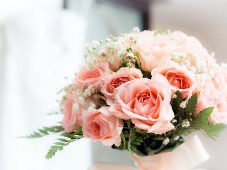 Photo for Wedding bouquet including pink roses. Celebration symbol. - Royalty Free Image
