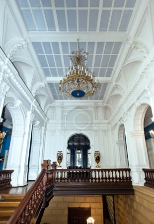 Photo for Grand hall in old majestic palace with oak staircase - Royalty Free Image