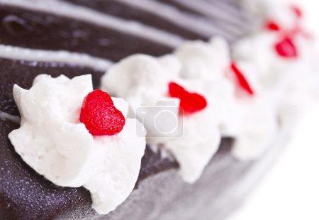Whipped cream on chocolate cake
