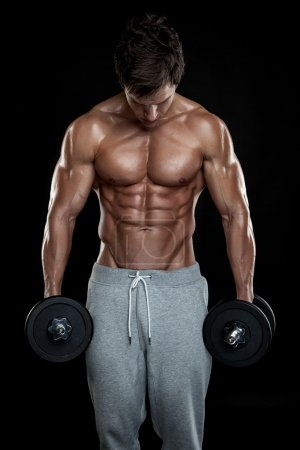 Photo for Muscular bodybuilder guy doing exercises with dumbbells over black background - Royalty Free Image