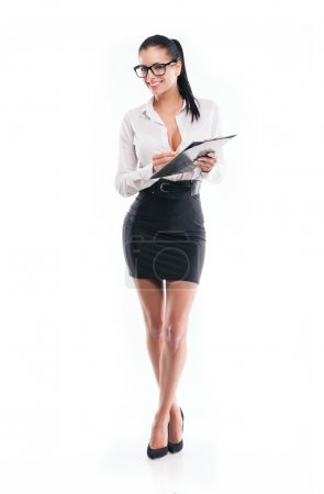 Young business woman with form and pencil