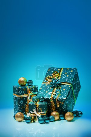 Gift boxes and christmas balls,Isolated on blue background