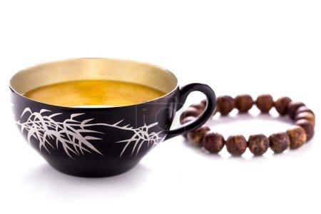 Photo pour Tasse à thé & Bracelet - image libre de droit