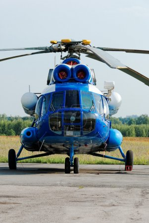 The Russian MI-8 helicopter is parked on parking of a take-off field