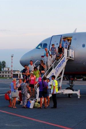 Passengers go down on a ladder from Aeroflot plane at Strigino's airport in Nizhny Novgorod