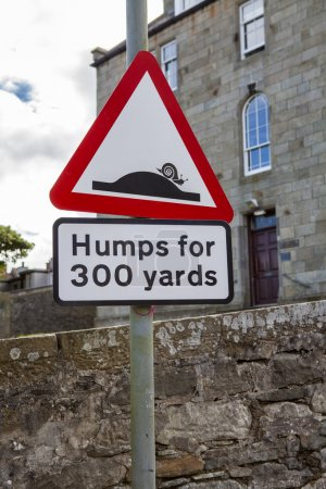 Humps for 300 yards street sign