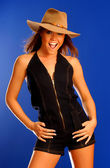 Professional Model Jenny Marie shoots a hot sexy set - blue jeans body suit - tan hat - happy girl smile and laugh