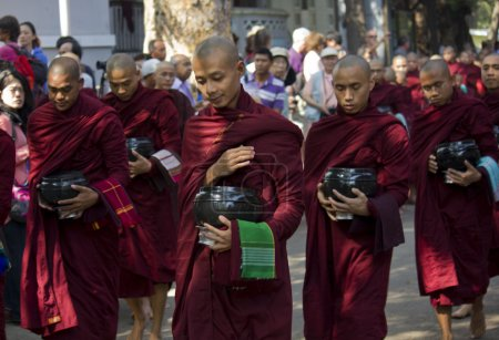 Monks in a row: Mahagandayon Monastery.
