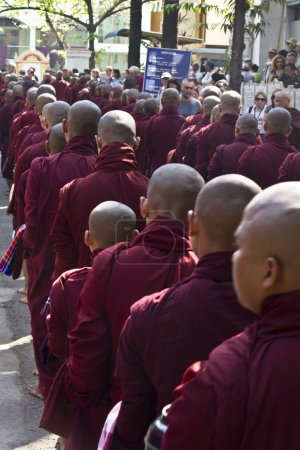 Monks in a row for lunch: Mahagandayon Monastery