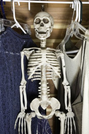 Photo for Human skeleton hanging in a clothes closet. - Royalty Free Image