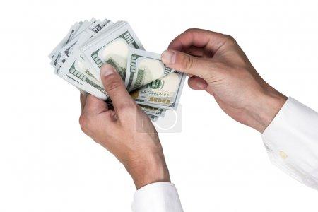 Photo pour Deux recomptage main paquet d'argent retournant à travers eux isolé sur fond blanc - image libre de droit