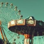 Vintage Retro Ferris Wheel on Blue Sky...