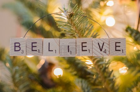 Photo for Wooden tiles spell the word believe in a homemade Christmas ornament - Royalty Free Image