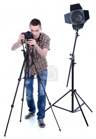 Photo for Portrait of young male photographer with professional digital camera in his studio - Royalty Free Image