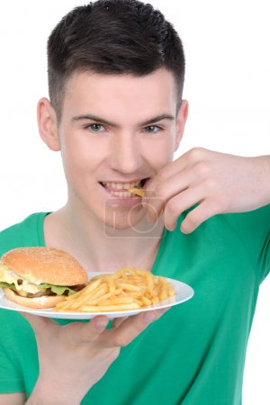 Photo for Young man eating fast food isolated on white background - Royalty Free Image